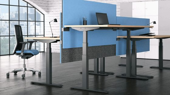 sit stand workstation with blue office screen and ergonomic chair